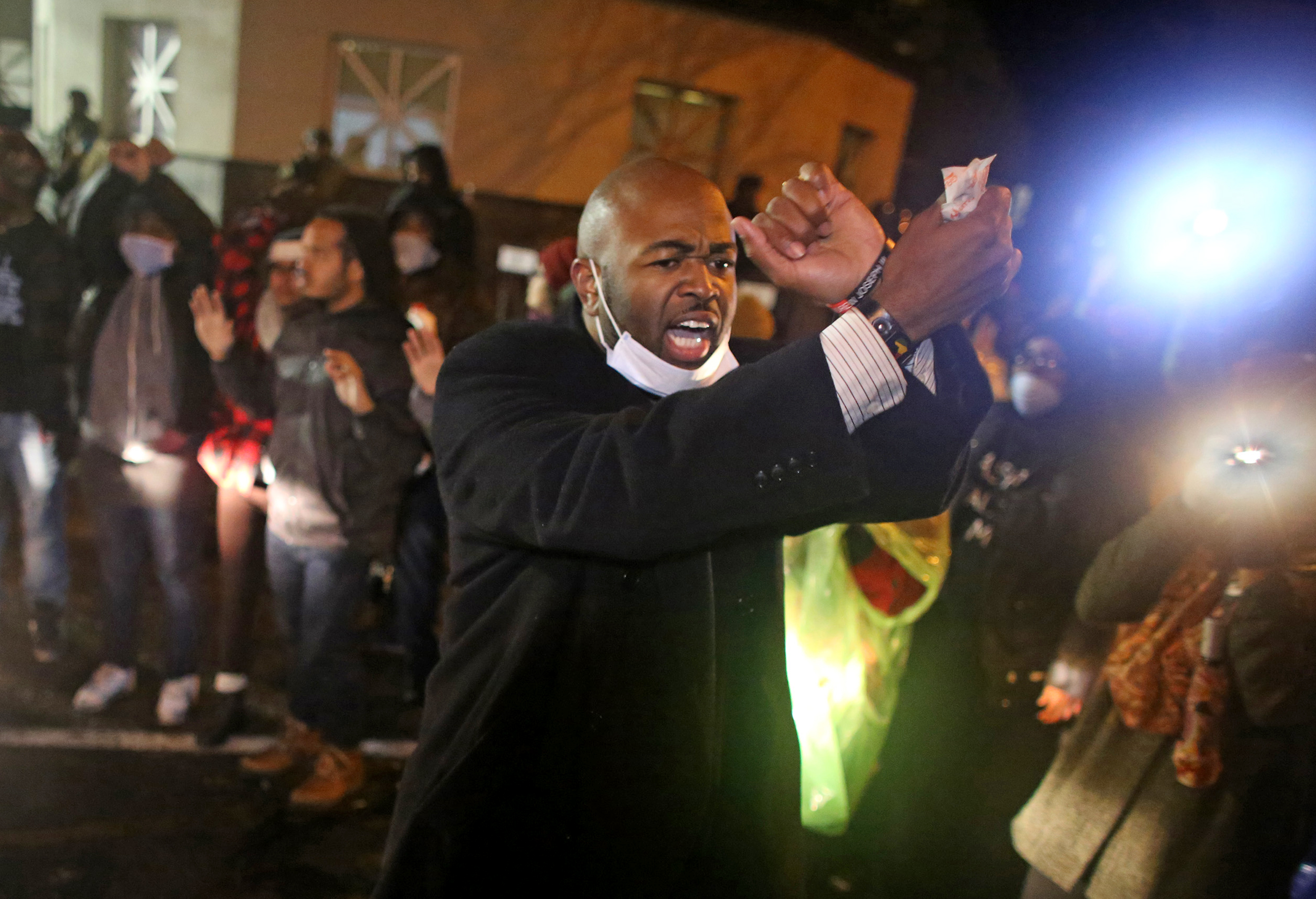 Jason Sole, of the NAACP lead the crowd in chanting and keep them at a safe distance after police in riot gear drove near the front of the Minneapolis Fourth Precinct ] (KYNDELL HARKNESS/STAR TRIBUNE) kyndell.harkness@startribune.com Black Lives Matter protested in front of Minneapolis Fourth Precinct in Minneapolis Min., Wednesday November 18, 2015. ORG XMIT: MIN1511182040320678