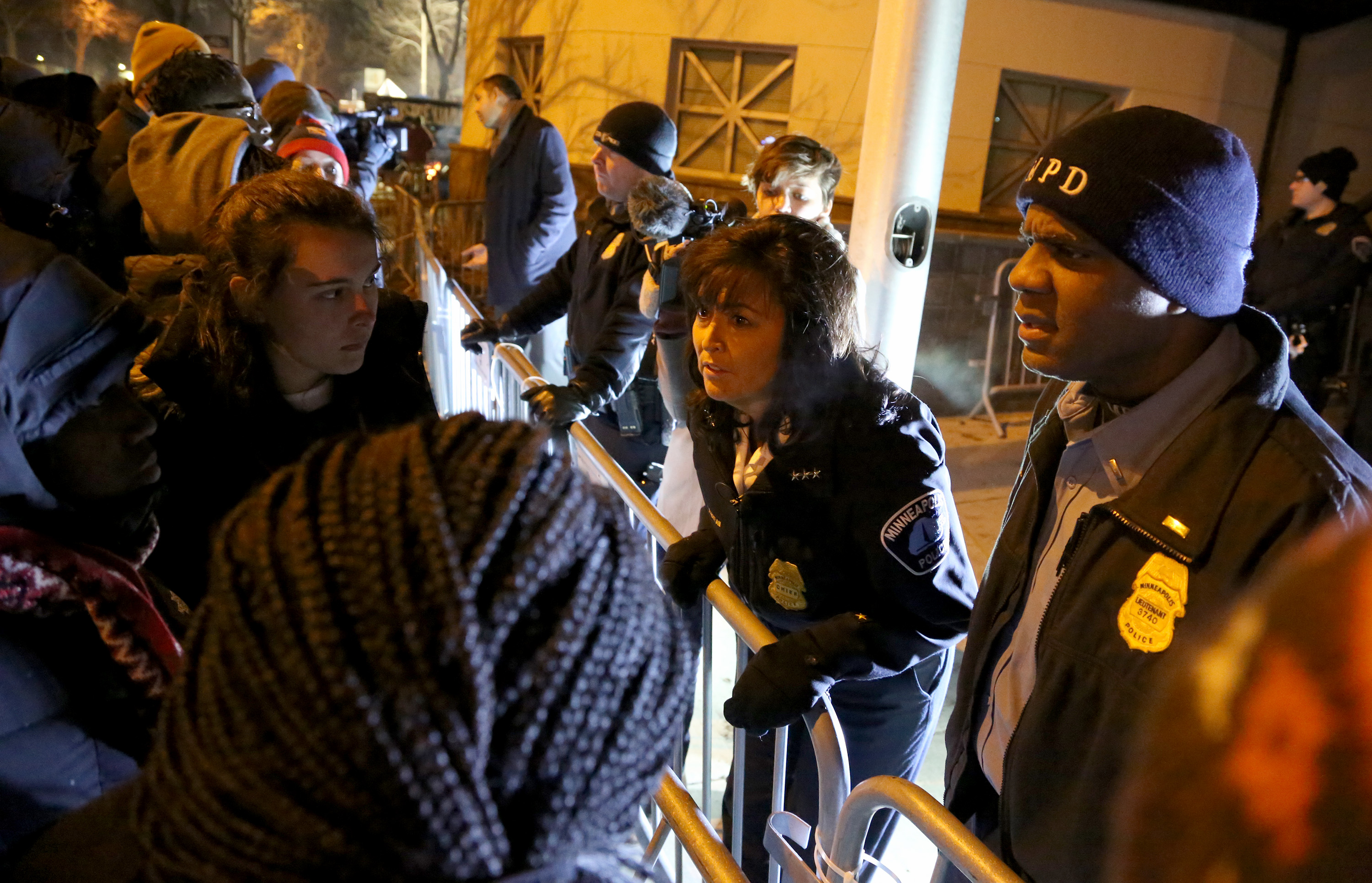 Minneapolis Police Chief Janee Harteau was asked a flood a questions from protesters in front of the Minneapolis Fourth Precinct. ] (KYNDELL HARKNESS/STAR TRIBUNE) kyndell.harkness@startribune.com Protesters in front of Minneapolis Fourth Precinct in Minneapolis Min., Friday November 20, 2015.