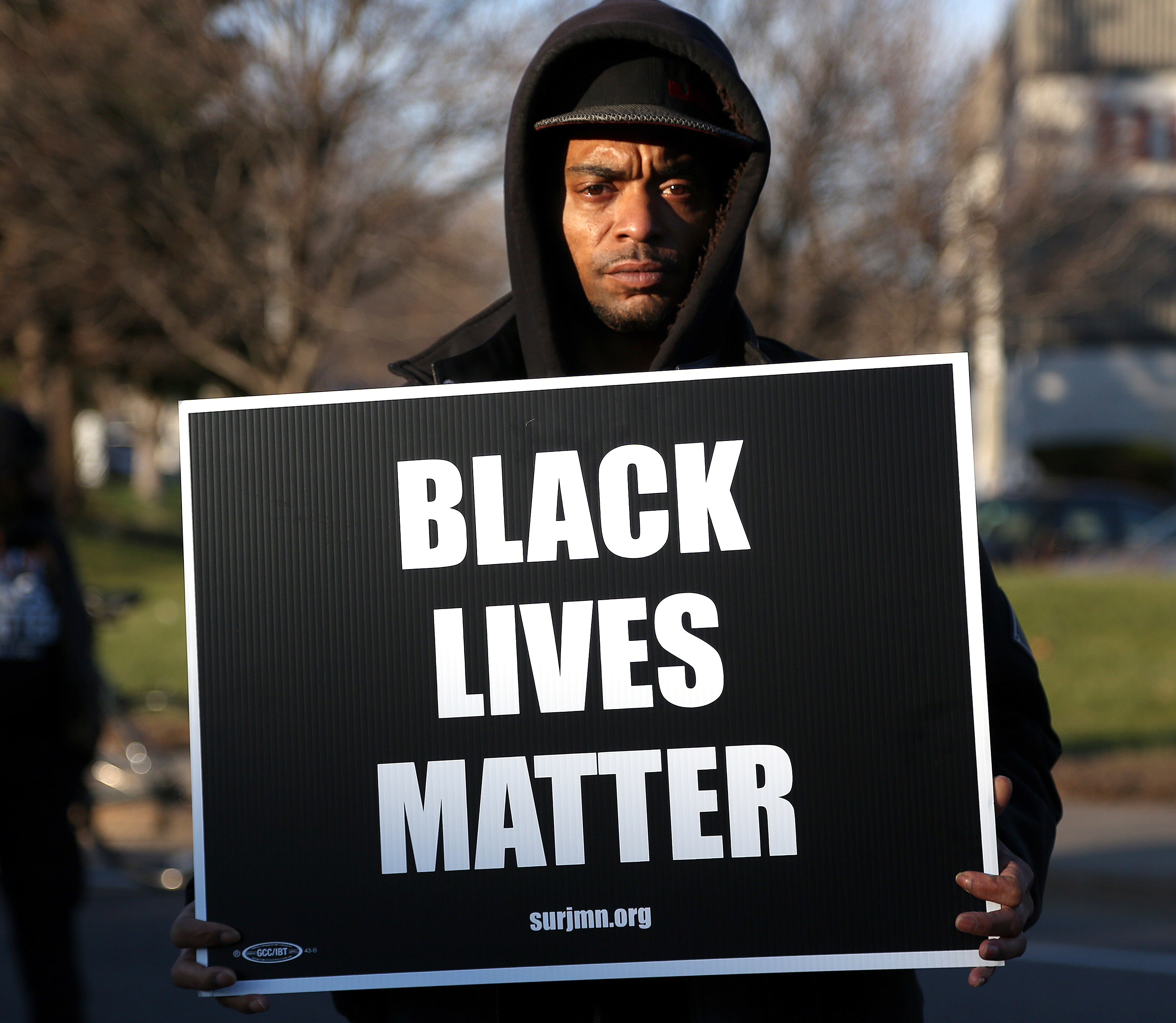 A community member held up his sign in front of the Fourth Precinct before heading down to the federal court house. ] (KYNDELL HARKNESS/STAR TRIBUNE) kyndell.harkness@startribune.com Protesters at the Minneapolis Fourth Precinct in Minneapolis Min., Saturday November 24, 2015. ORG XMIT: MIN1511241940380214