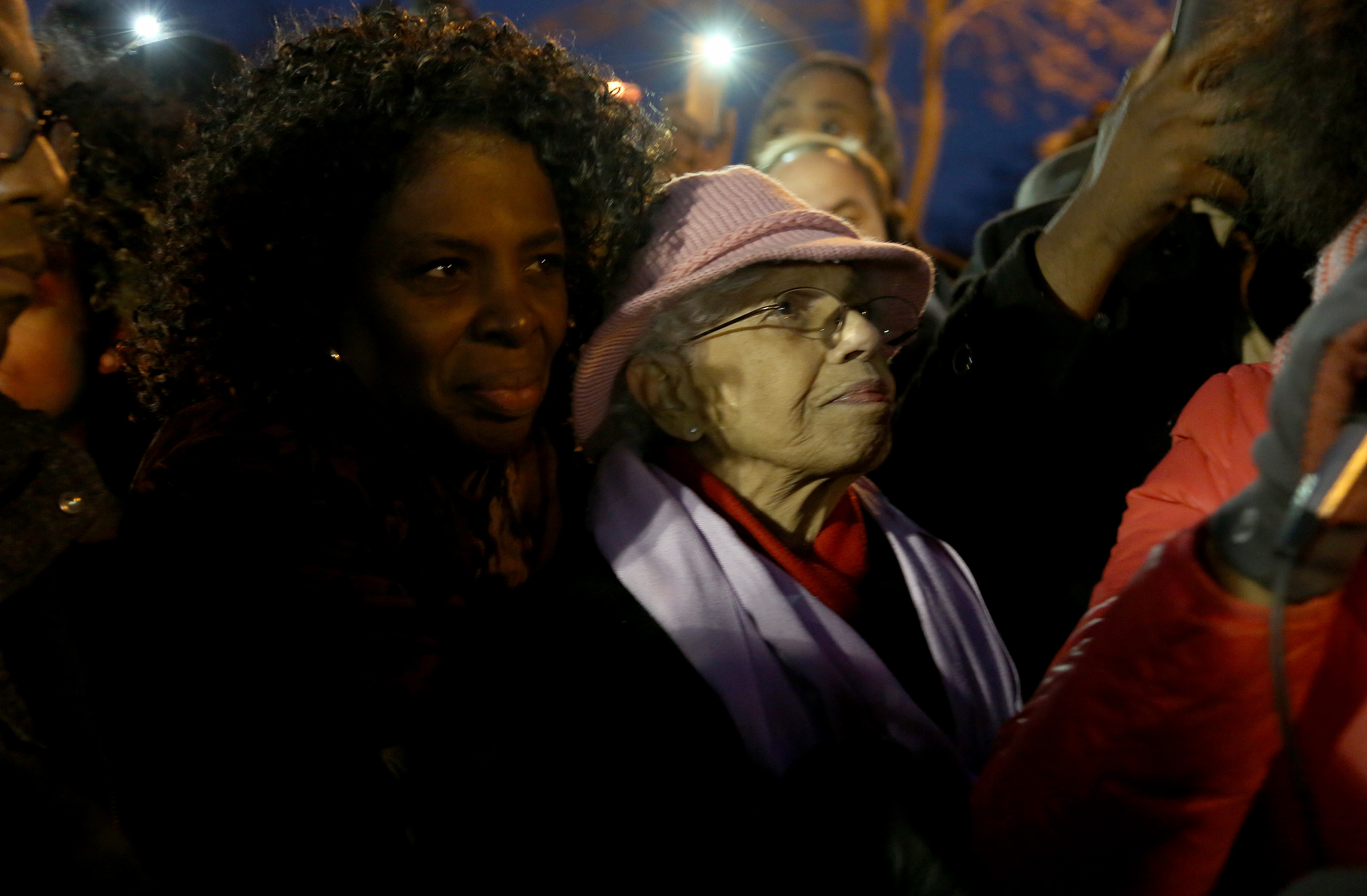 Josie Johsnon listened to speakers during a vigil held in front of the Minneapolis Fourth Precinct. ] (KYNDELL HARKNESS/STAR TRIBUNE) kyndell.harkness@startribune.com Protesters in front of Minneapolis Fourth Precinct in Minneapolis Min., Friday November 20, 2015. ORG XMIT: MIN1511201912230205