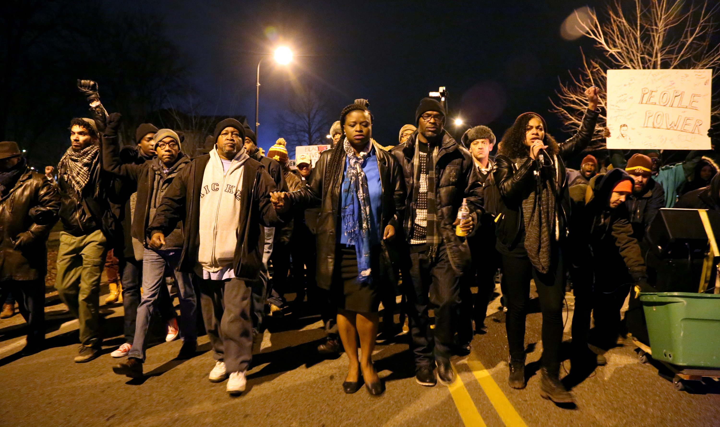 Demonstrators outside the Minneapolis Police Department's 4th Precinct split off and walk to the site where Jamar Clark was shot by police, on Friday, Nov. 20, 2015. (Kyndell Harkness/Minneapolis Star Tribune/TNS) ORG XMIT: 1176971