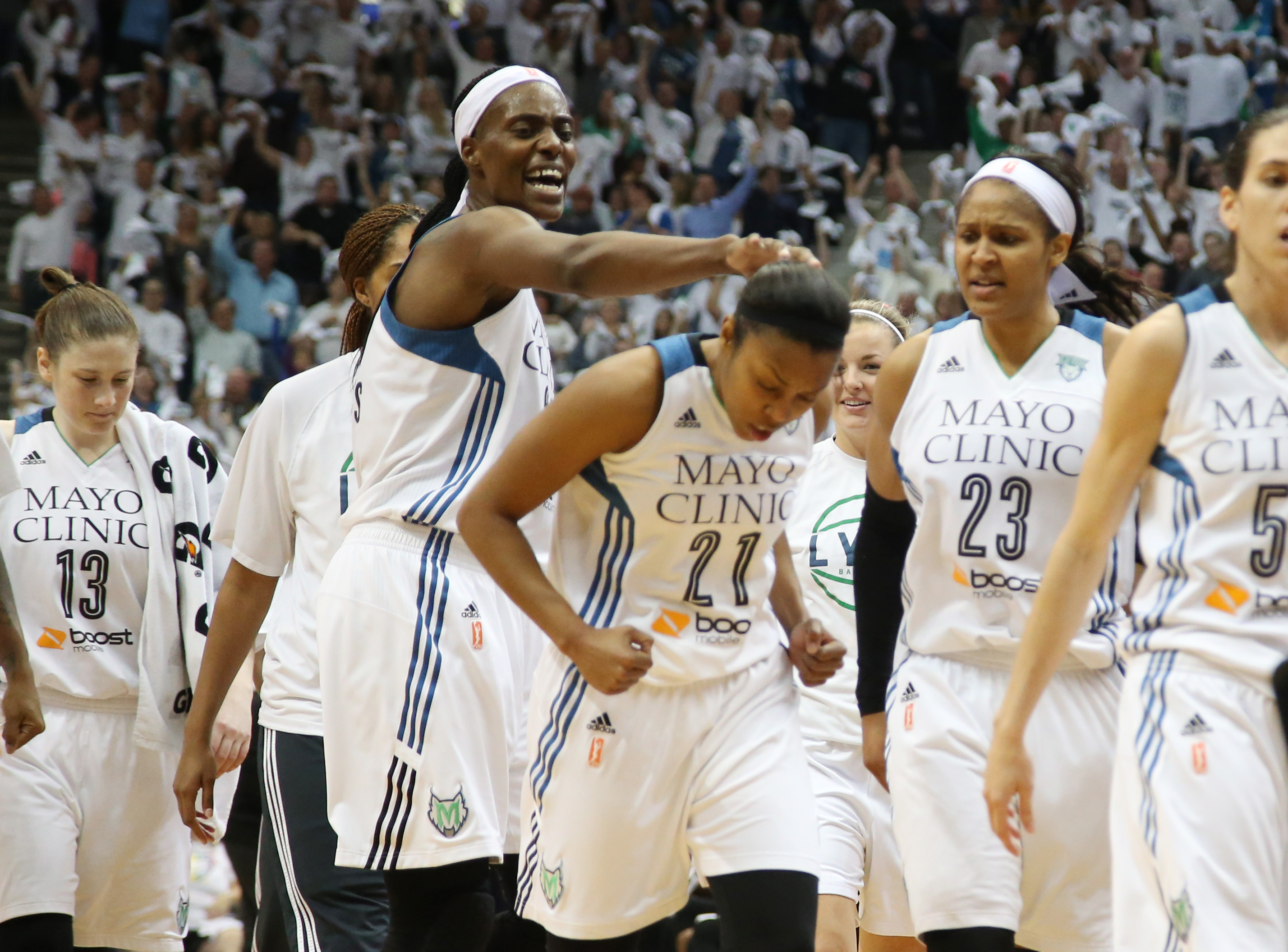 Minnesota Lynx center Sylvia Fowles (34) congratulates Minnesota Lynx guard Renee Montgomery (21) during the second half.   ] (KYNDELL HARKNESS/STAR TRIBUNE) kyndell.harkness@startribune.com  Game 5 of the WNBA finals Lynx vs Indiana at the Target Center in Minneapolis, Min., Wednesday October 14,  2015.